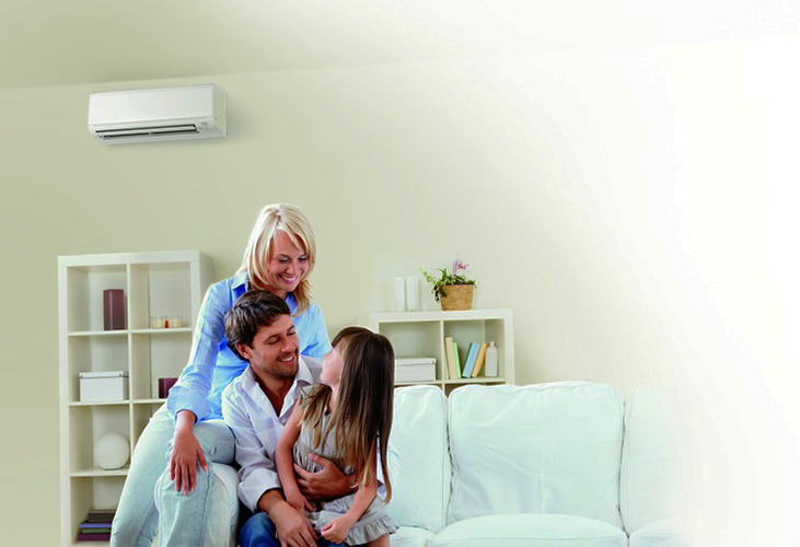 Family in basement with Mitsubishi ductless system