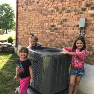 Customer's family with new Trane system